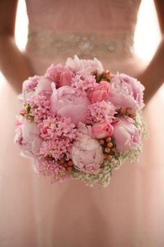 One of my favorite bridal bouquet that i made, May is her name for my website composed of flowers in a shades of pink like peonies, tulips, ranunculus, hyacinth with peach berries and million stars.