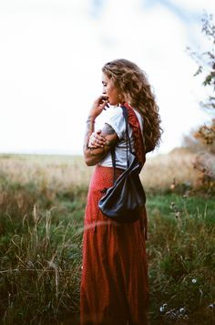 Love these natural curls... and I've got to get one of those cute little backpacks!