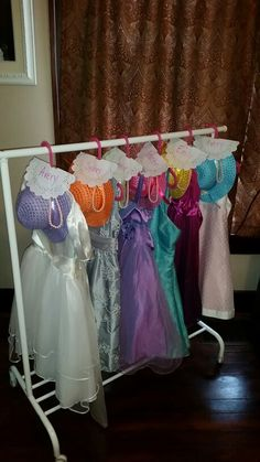 Tea Party birthday dresses!! Formal dresses from Goodwill or Once Upon a Child, Hats (and matching bags) from Amazon - all 6 for about $20, cheap costume pearls, Ikea kid hangers and rack. The girls LOVED them and got to take them home!! Inexpensive way to really dress up a tea party!!