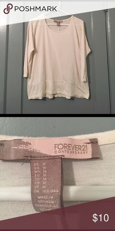 F21 Contemporary top This is a beige colored top.  Sleeves are just a bit longer than 3/4. Worn just a few times.   No signs of wear or tear. Forever 21 Tops Tees - Long Sleeve
