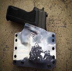 Marines raising the flag over Iwo Jima, one of the best kydex holsters I've ever seen.