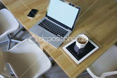 Laptop,pad,mobile phone and notebook on table