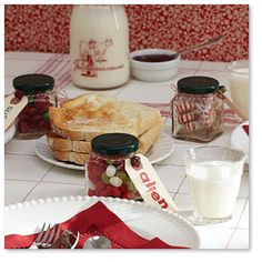 Recycle those old mini jam jars with some Christmas candy to double as a place card and treat for your Christmas guests.