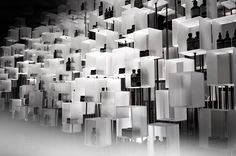 Aesop I.T Installation by cheungvogl in Hong Kong, China Cheungvogl have beautifully designed the I.T HYSAN ONE flagship store with the surprise element of sound, scent and touch attached to some of the eight hundred resin boxes. An installation with an industrial feel carefully lit to accentuate the feel that each of these boxes is being drawn upward by an invisible thread.