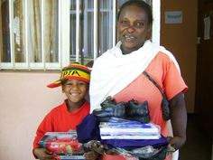A little car, a pair of shoes, blank exercise books... Presents for a smiling ethiopian family supported by CIFA