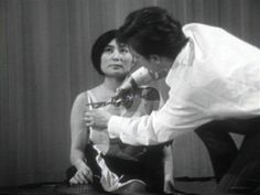"Excerpt from ""Cut Piece,"" a performance by Yoko Ono, 1964."