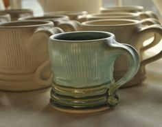 Lucia Pottery -- love the way the handles meet the bottom of the mug
