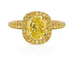 You cant see it in the picture but Andrea Riseborough also wore this magnificent De Beers Aura yellow diamond ring to the BAFTAs, with 59 yellow diamonds set in yellow gold.