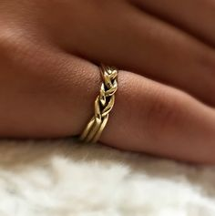 A most beautiful 14 karat gold ring, made of three wires and braided in the front. A timeless ring that looks delicate yet very impressive. A perfect