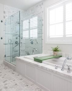 Chic frameless glass shower doors in Beach Style Orange County with White And Gray Granite next to Tub Shower Tile alongside Frameless Glass Shower Door and Bathroom Window Treatment Bathroom Window Treatments, Bathroom Windows, Bathroom Interior, Contemporary Bathrooms, Modern Bathroom, Master Tub, Dream Bathrooms, Master Bathrooms, Small Bathrooms