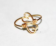 LOVE THIS! Just bought it:) Gold Wire Double Hearts Ring  Heart To Heart Ring by FabulousWire, $12.99