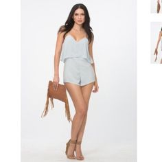 ✨The Kareena Romper by Cleobella BNWT Available in XS, S or M.   SOLD OUT EVERYWHERE  Rayon short playsuit Thin adjustable straps Lace trim detail Measurements (Small): 17in bust, 23in length Model is wearing size small Cleobella Pants Jumpsuits & Rompers