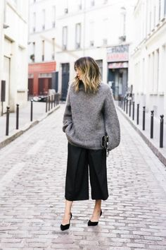 5 Perfect Fall Work Outfit Ideas - Play with proportion by pairing an oversized sweater with cropped wide pants or culottes. Add black heels to make it office-ready.