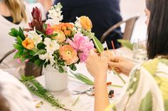 guests creating their own beautiful spring bouquets at a floral workshop in Milwaukee, WI