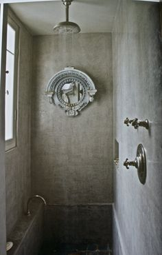 Zinc window frame used as a mirror in a shower