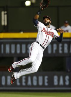 Atlanta Braves right fielder Jason Heyward (22) makes a leaping catch for an out on a line drive by Chicago Cubs' John Baker in the sixth inning of a baseball game .
