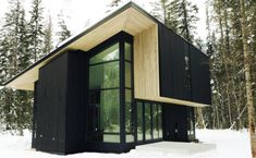 Pioneer model prefab has 1,740 square feet, a mono pitch roof, 180 degrees of floor-to-ceiling glass, and a smart design with large overhangs and cross ventilation. $124,900