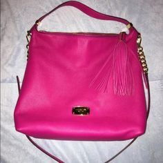Hot pink Michael Kors bag Hot pink Michael Kors over the shoulder bag. Barely used, perfect condition!! Price is reasonable for condition. No rips, stains, defects, etc. This bag can hold a lot and is perfect for spring/summer! ☀️💜 The price above is for the bag and three wallets all of different sizes. If you would like just the bag, let me know! Feel free to make an offer! Michael Kors Bags Shoulder Bags