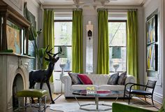 Eclectic Living Room With Bold Chartreuse DrapesBright green drapes add a colorful impact to this white eclectic living room. The room also features a gorgeous white leather sofa, animal hide rug, and large deer sculpture. Small Living Rooms, Living Room New York, Curtains Living Room, Color Palette Living Room, Living Room Green, Living Room Color, Green Curtains, Eclectic Interior Design, Eclectic Living Room
