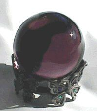 amethyst crystal ball with pewter jewel butterfly stand.