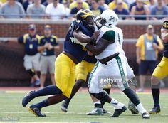 News Photo : Rashan Gary of the Michigan Wolverines battles...