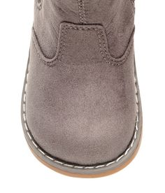 Check this out! Warm, lined ankle boots with a zip in one side and elastic panel at other side. Loop at back, faux fur lining and insoles, and rubber soles. - Visit hm.com to see more.