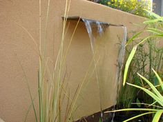 Beautiful Walls and Fences for Outdoor Spaces: This stucco wall has a water feature built right in it. Designer Sierra Hart used copper and stone elements for a contemporary look. From DIYnetwork.com