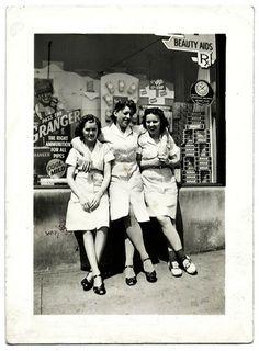 Three Waitresses Outside a Drug Store, c. 1940s. Gelatin Silver Print Snapshot