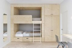 This bunk bed is clearly custom made and it shows that the bed area can have a wardrobe and lots of storage, leaving the rest of the room clear for play. They've even built in drawers under the bed which is perfect for toys that the kids can easily get to. http://petitandsmall.com/coolest-bunk-beds-kids-room/