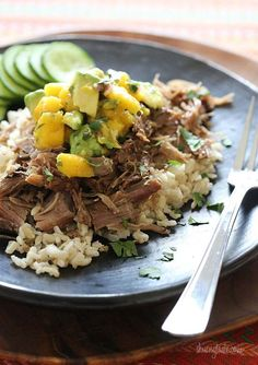 I love this dish. I make it with a copycat recipe of Chipotle's Cilantro Lime Rice. I also use boneless country style ribs instead of a roast and it cuts the cooking time to about 4 hrs on high. Sooo yummy and my husband loves it!!