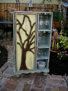 This is our latest design in our series of Oak Tree Door Cabinets! Description from etsy.com. I searched for this on bing.com/images