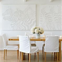 Wall art with a relief pattern takes this dining space from monochromatic to dramatic. | Coastalliving.com