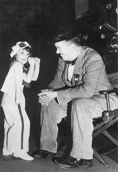 Stan with child actress Patsy May  on the set of Blockheads.