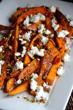 Roasted sweet potato wedges are topped with crunch chopped pistachios, tangy goa. Roasted sweet potato wedges are topped with crunch chopped pistachios, tangy goat cheese and a pomegranate glaze in this easy winter side dish recipe. Side Dish Recipes, Veggie Recipes, Vegetarian Recipes, Cooking Recipes, Healthy Recipes, Dessert Recipes, Greek Recipes, Salmon Recipes, Think Food