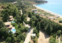 The area has a number of excellent beaches, often with a choice of tavernas or bars right on the water's edge, ranging from Lourdas' own to neighbouring Kanali and Trapezaki. Beach Villa, Beautiful Villas, Beaches, Greece, Scenery, Number, River, World, Outdoor