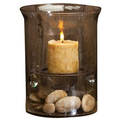 """Textured glass candleholder.  Product: CandleholderConstruction Material: GlassColor: BrownAccommodates: (1) Pillar candle - not includedDimensions: 10"""" H x 7.75"""" Diameter Notes: Stones not included"""