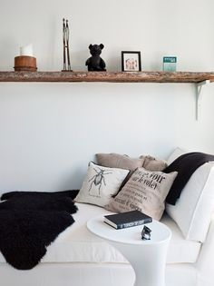 Like the worn board against all white, with a modern side table