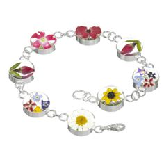 The 'Mixed Flower' jewellery is part of our flower range made using dried flowers set into a clear acrylic resin and set in sterling silver.