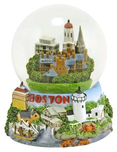 Boston snowglobe. The snow globe perspective on Faneuil Hall, the Old State House, Old North Church, the U.S.S. Constitution and many more Beantown sites. Music box plays Red Sails in the Sunset. Cast resin base/glass globe. 5-1/2 (14 cm) inches tall.