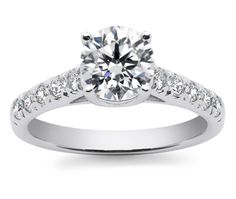 Trellis Diamond Ring in White Gold  Ten round cut diamonds are prong set in this white gold diamond engagement ring setting, accenting your choice of center diamond. Proudly made in the USA.  Price: $850.00