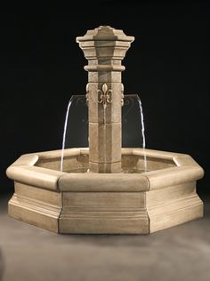Fiore Stone, Inc. The Plaza features four elegant Fleur De Lis designs which originate at each of the four metal spouts. c.