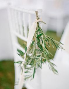 Hang greenery from chairs for a pretty look for your ceremony or reception seating.