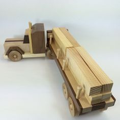 Handmade Wood Tractor Trailer available at bluebirdwoodcrafts.com. Includes 8 logs.