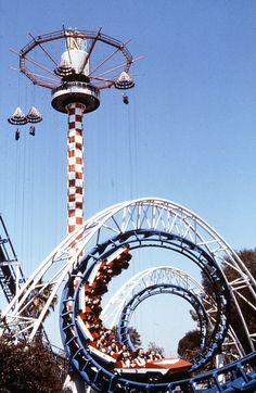 In the 1970s, roller coasters made their first appearance inside Knotts Berry Farm. This photo from circa 1980 shows the Corkscrew roller coaster in front of the Parachute Sky Jump ride. Courtesy of the Orange County Archives.