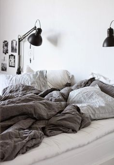 Linen bed sheets. Grey white bedroom