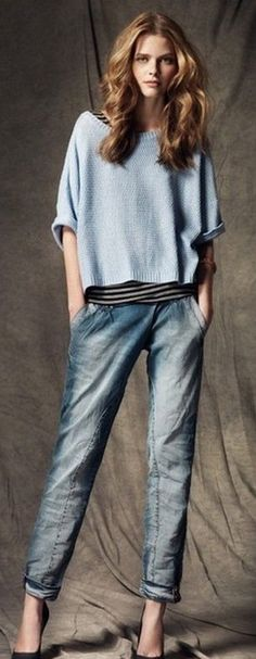 Women's fashion | Boyfriend jeans, loose blue sweater over stripes, heels, big hair