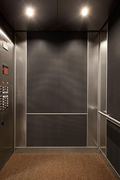LEVELe-102 Elevator Interior with customized panel layout; Capture panels in Bonded Aluminum with Dark Patina and Vancouver pattern, Stainless Steel with Seastone finish; ceiling in Stainless Steel with Seastone finish; Round handrail at Promenade II Parking Garage, Atlanta, Georgia Elevator Lobby Design, Garage Lift, Lift Design, Ceiling Design Living Room, Cupboard Design, Healthcare Design, Luxury Interior, Modern Design, Layout