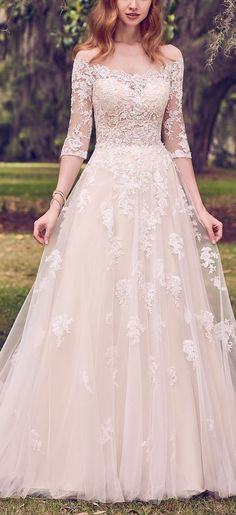 Maggie Sottero - BREE, Romantic lace motifs cascade over tulle in this illusion off-the-shoulder, A-line wedding dress.