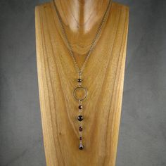"""Day 5 - Ridiculously long garnet pendant. This pendant didn't """"work"""" for me until it was five inches long. The necklace is oxidized sterling silver with faceted and smooth garnet."""
