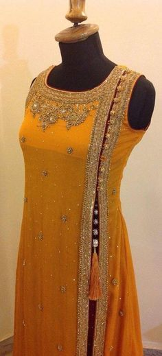 Enchanting suit in yellow, cut on the side with a fetching little tassel too. See more bridal wear ideas on Wedding Vows. Kurta Designs, Blouse Designs, Indian Attire, Indian Wear, Pakistani Outfits, Indian Outfits, Collection Eid, Style Indien, Desi Clothes